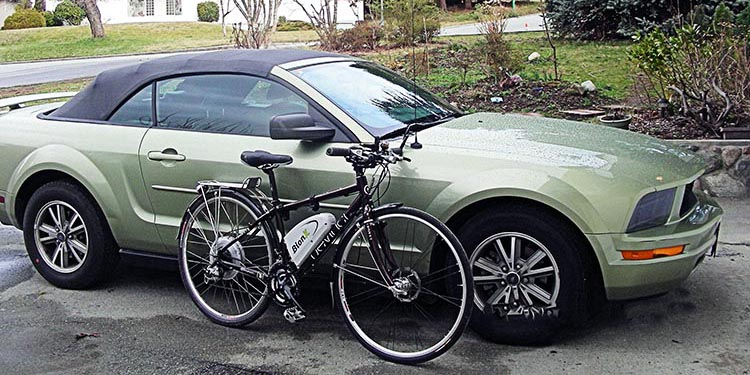 Can anyone seriously believe that this electric bike is as harmful to the environment as this car? That's my Devinci Copenhagen hybrid bike, retrofitted with one of the excellent BionX electric bike conversion kits.