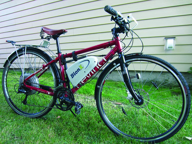 This is an example of a bike retrofitted with an electric bike kit. It's a Devinci Sydney hybrid regular bike, with a BionX hub-drive motor added on to it. You can read a review of the premium BionX e-bike conversion kits here