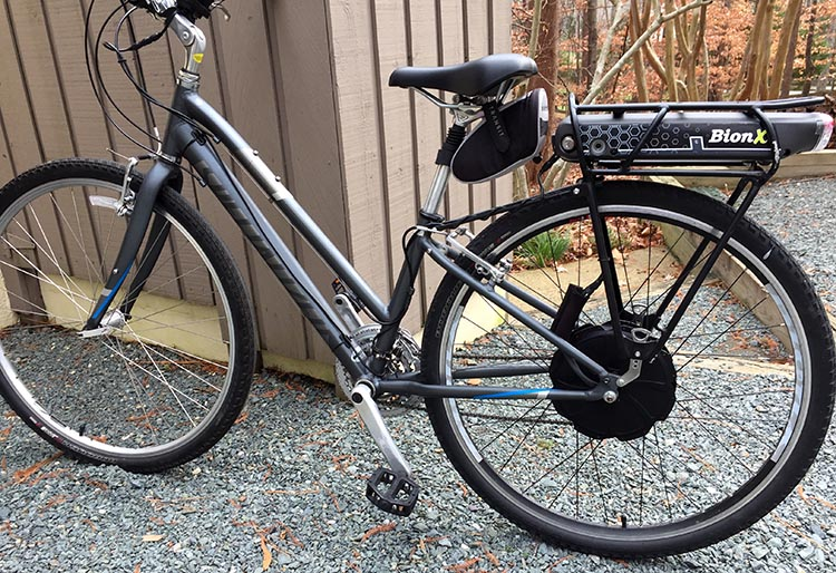 Dr. Len's wife rides a Specialized hybrid bike with a BionX Electric Assist Kit, and the battery on the rack