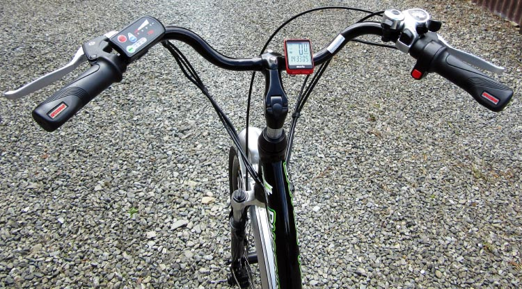 I control the three levels of power on my electric bike with the console on my handle bars (left). I also have a throttle for power bursts on uphill pull-offs