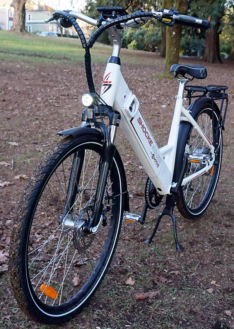 This photo shows how bright the front light is, even in the daylight. Ampere Electric Bike Review