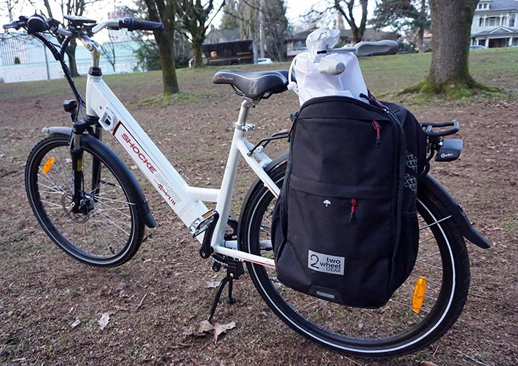 The Ampere E-bike is pre-fitted with a sturdy rack. Here is is with my Two Wheel Gear pannier attached to the rack, and my tripod shoved into the pannier! Ampere Electric Bike Review
