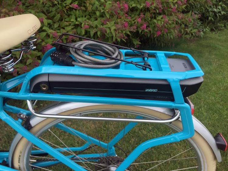 The li-ion battery on the Cube Elly Ride 400 Hybrid electric bike is neatly tucked under the integrated bike rack. You can read about this beautiful crank-drive ebike here