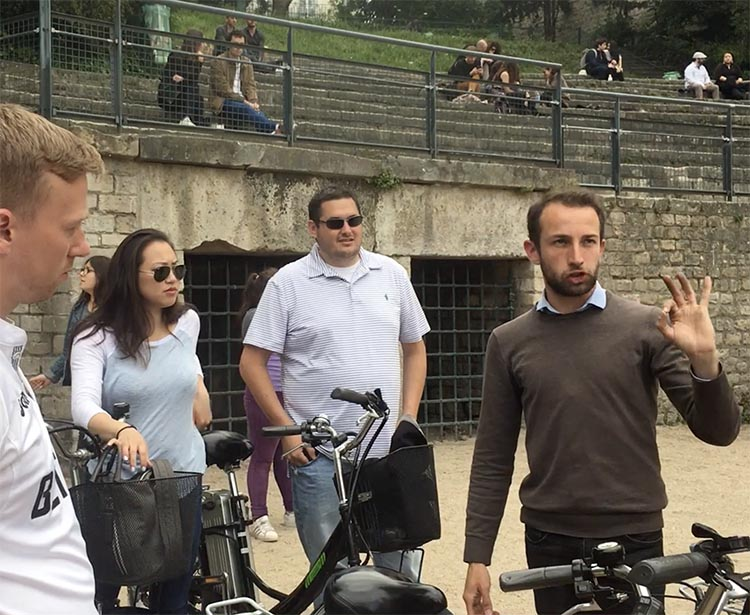 We stood besides the gates that once were used to let lions into the arena. Guided electric bike tour of Paris