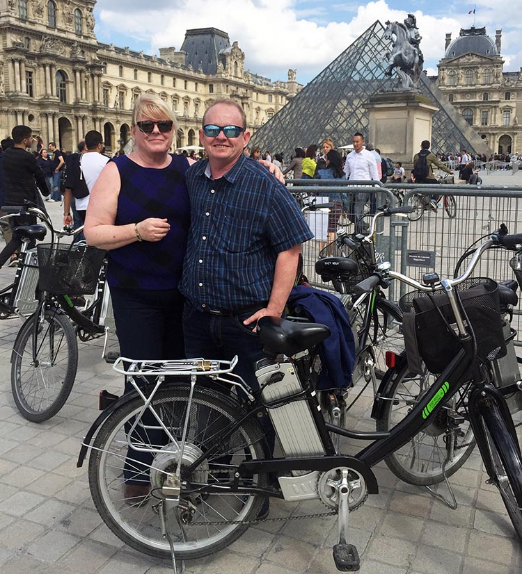 Here we are outside the Louvre museum. We were by far the oldest tour participants, but it made no difference at all, thanks to ebikes. Guided electric bike tour of Paris