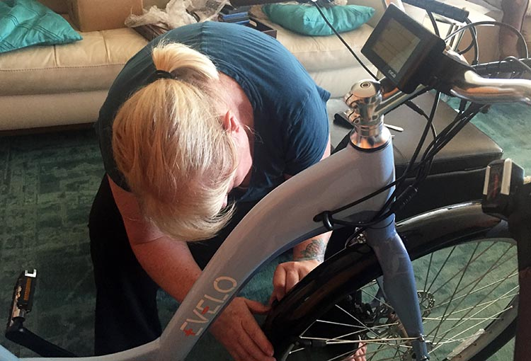 Assembling the Evelo Galaxy ST e-bike. Maggie assembling the Evelo Galaxy 3
