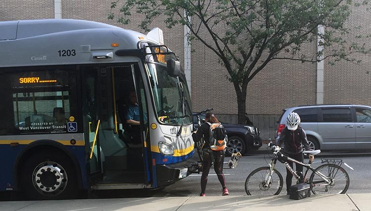 In Vancouver you can load your bike onto most buses. But it is not that easy to do, and once you add a lot of extra weight to a bike, it can be close to impossible