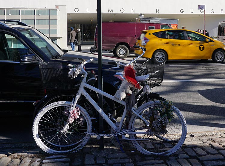 Why is the Mayor of New York Waging War on Ebikers? A ghost bike we saw across the road from the Guggenheim Museum in New York. Ghost bikes are memorials to cyclists who have been killed by motorists