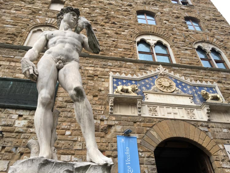 Our Electric Bike tour of Florence: The replica statue of Michelangelo's David outside the Uffizi Museum. Electric Bike Tour of Florence