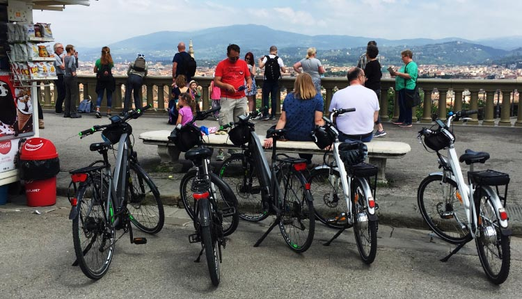 Our Electric Bike tour of Florence: Our bikes parked at the Piazza Michelangelo, where we enjoyed the view, and bought ice-cream and souvenirs