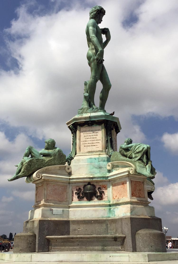 Our Electric Bike tour of Florence: In the center of the Piazza Michelangelo is another giant replica of Michelangelo's David, flanked by other statues, in an impressive homage to Michelangelo