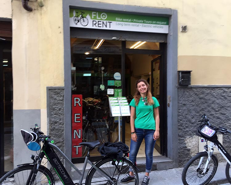 Our Electric Bike tour of Florence: Our ebike tour guide, Alessia Fasulo, outside her Flo Rent bike rentals store