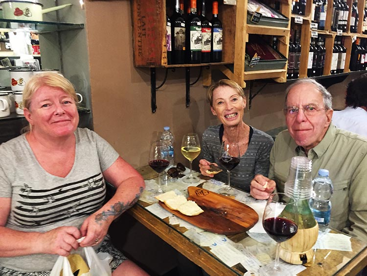 Our Electric Bike tour of Florence: Maggie enjoying complimentary wine and snacks with Sharon and George. Well deserved after four hours cycling in the sun!