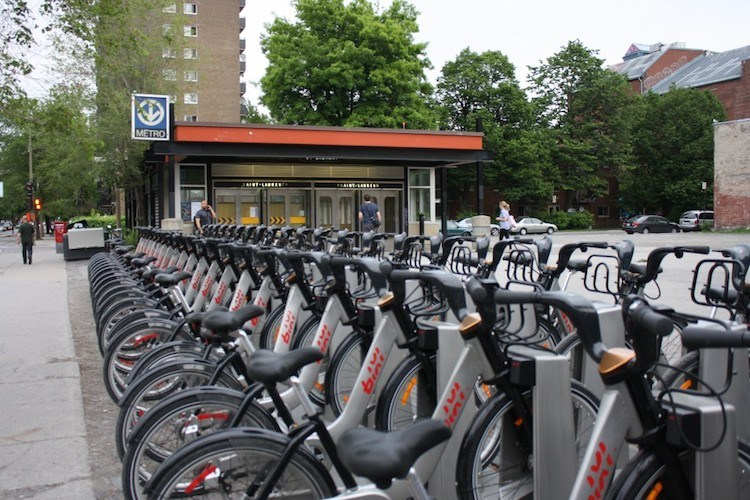 Bixi shared bikes at a docking station in Montreal, conveniently outside a Metro station