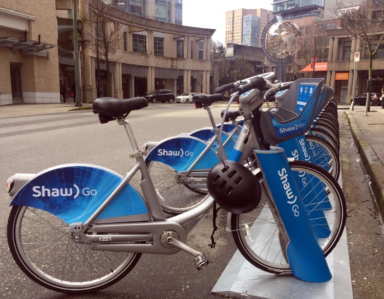 Mobi bikes (rebranded as Shaw Go bikes) at a docking station in downtown Vancouver, conveniently near a skytrain station