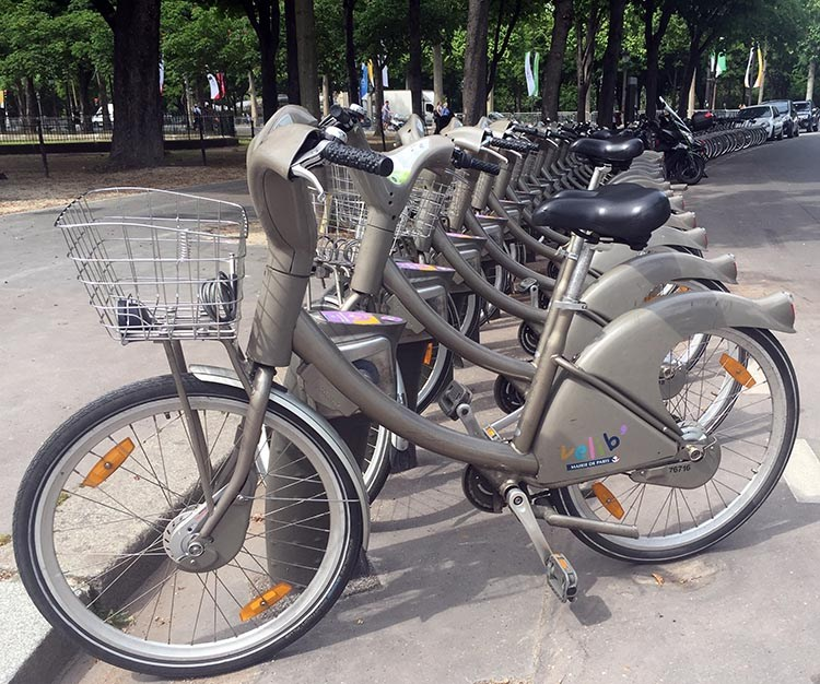 Velib shared bikes at a docking station in Paris, near the Champs-Élysées