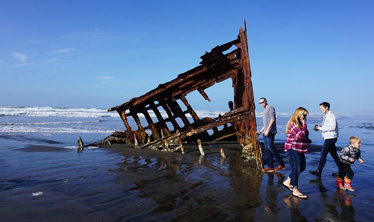 Riding Ebikes on the Trails at Fort Stevens State Park, Oregon. The wreck of the Peter Iredale
